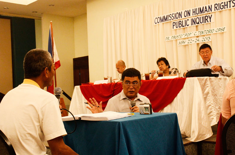 RECANTATION.  Dominador Mantangkil Damlayon (with his back to camera), one of the witnesses presented by Task Force Tentorio in 2012, tells the Commission on Human Rights (CHR) Wednesday that he wasn't around when Italian priest Fausto 'Pops' Tentorio was murdered last October 2011 in Arakan town, Cotabato.  He added the Task Force Tentorio made him sign a paper which he didn't understand because it was written in English.  The CHR led by Chair Etta Rosales is in Davao City for the three-day public inquiry for Tentorio's case.  (davaotoday.com photo by Medel V. Hernani)