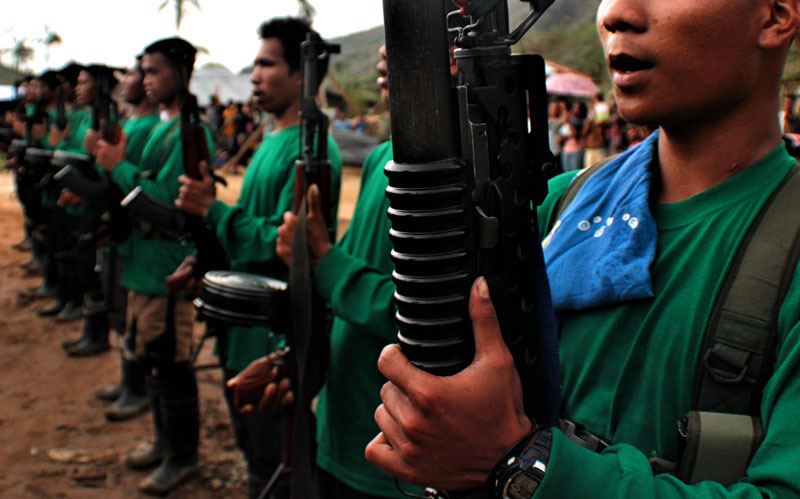 Communist guerillas sing Internationale during an activity last March in one of the villages of Compostela Valley province. (davaotoday.com file photo by Ace R. Morandante)