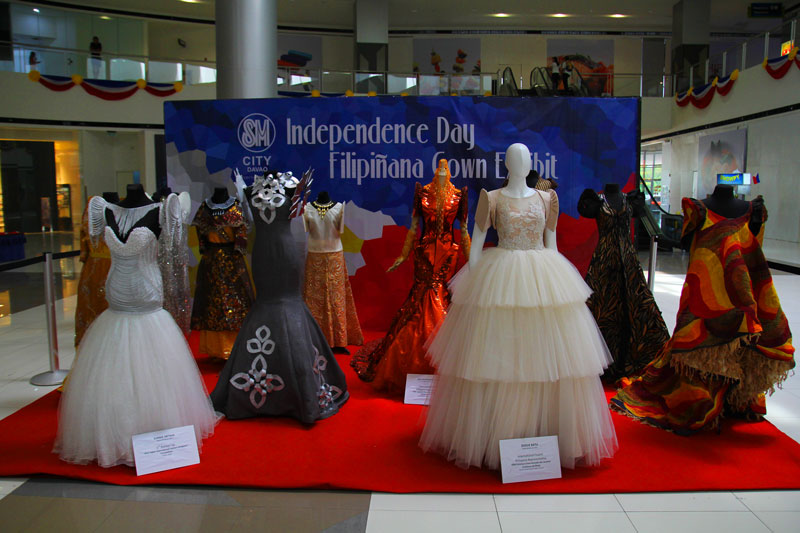 INDEPENDENCE DAY FASHION.  Local couturiers exhibit their version of Filipiniana gowns in SM Ecoland, Davao City, just days before the 115th year celebration of Philippine Independence Day.  (davaotoday.com photo by Ace R. Morandante)