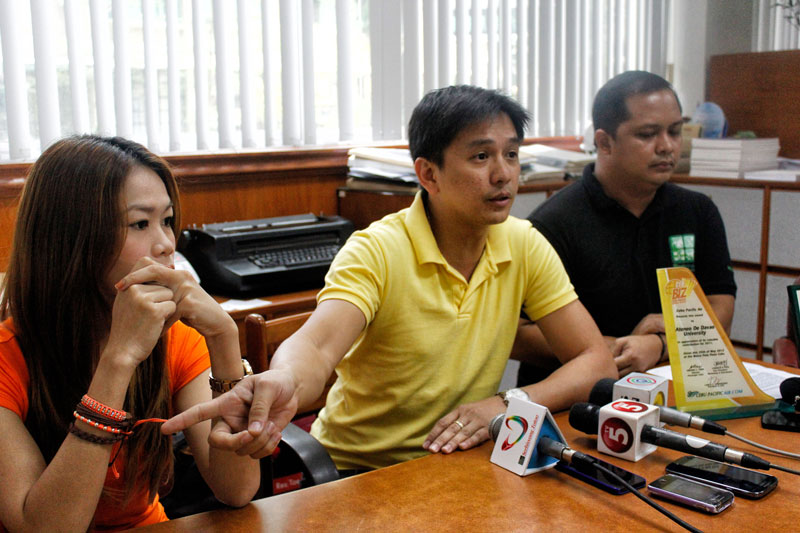 "IRATE.  Ateneo de Davao University teacher Jess Delgado (middle) and student Giselle Escobañez (left) recall their harrowing experience with Cebu Pacific's Flight 5J 971 in a press conference Tuesday.  The university recommended a boycott of the airline company for its ""ineptness and insensitivity"" in dealing with passengers following the runway mishap Sunday evening at the Francisco Bangoy International Airport.  (davaotoday.com photo by Medel V. Hernani)"