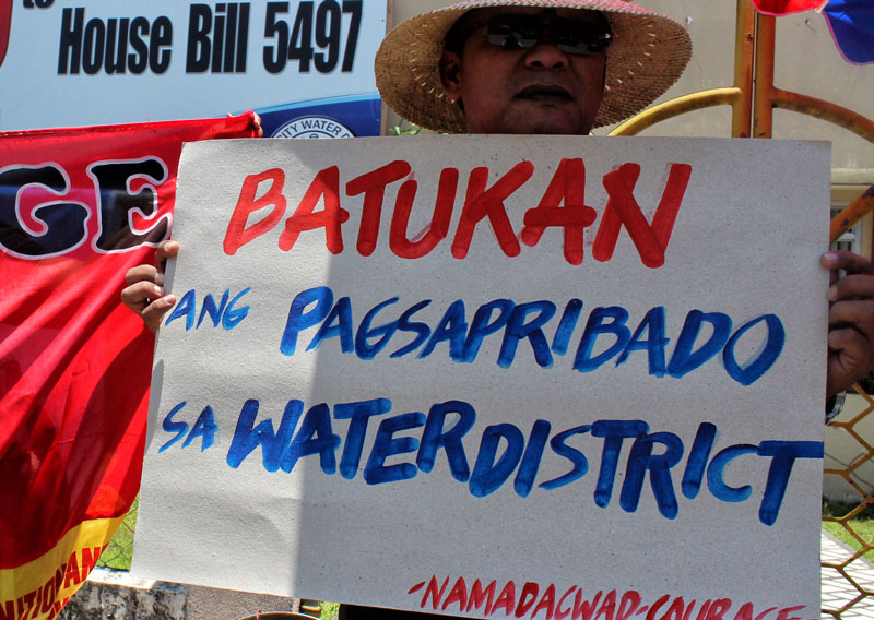 A member of Namadacwad protests the planned privatization of the Davao City Water District.  (davaotoday.com file photo by Medel V. Hernani)