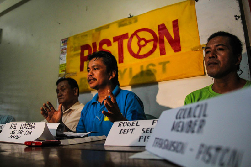 """WE'RE NOT CONSULTED.""  Drivers' group Transmision-Piston in Southern Mindanao, led by its secretary general Edil Gonzaga (middle), slams on Tuesday the Davao City government for its immediate implementation of City Ordinance No. 0280 or the Anti-Smoke Belching Ordinance. Gonzaga said the local government did not formally consult the city's drivers and operators.  (davaotoday.com photo by Ace R. Morandante)"