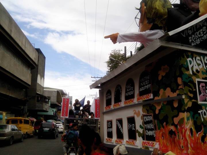 WHERE TO P-NOY? Is this the road to tuwid na daan? Bayan's effigy shows President Aquino atop his palace filled with policies which the group says only worsens poverty and human rights abuses. (davaotoday.com photo by John Rizle L. Saligumba)