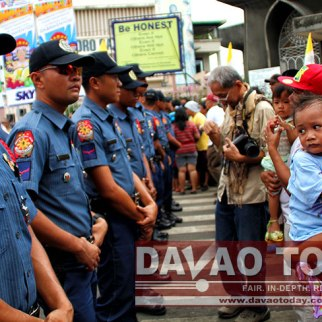IS THIS A RALLY OR PARADE? Sunday's Pamulak sa Kadayawan Float Parade looked more like a rally with many police flanking the streets to keep off parade watchers from coming near the streets. (davaotoday.com photo by Jandy Ken C. Lizondra)