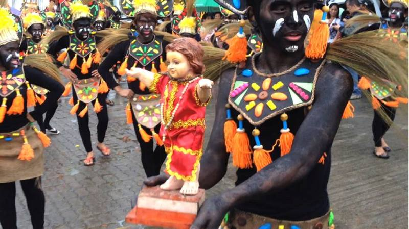 SINULOG FESTIVAL IN SANTO TOMAS    Residents of the municipality of Santo Tomas, Davao del Norte perform their version of the Sinulog festival celebrating the Feast of Santo Nino here along San Miguel Parish Church led by the Aklan Ati-Atihan Foundation. (Mart D. Sambalud/ davaotoday.com)