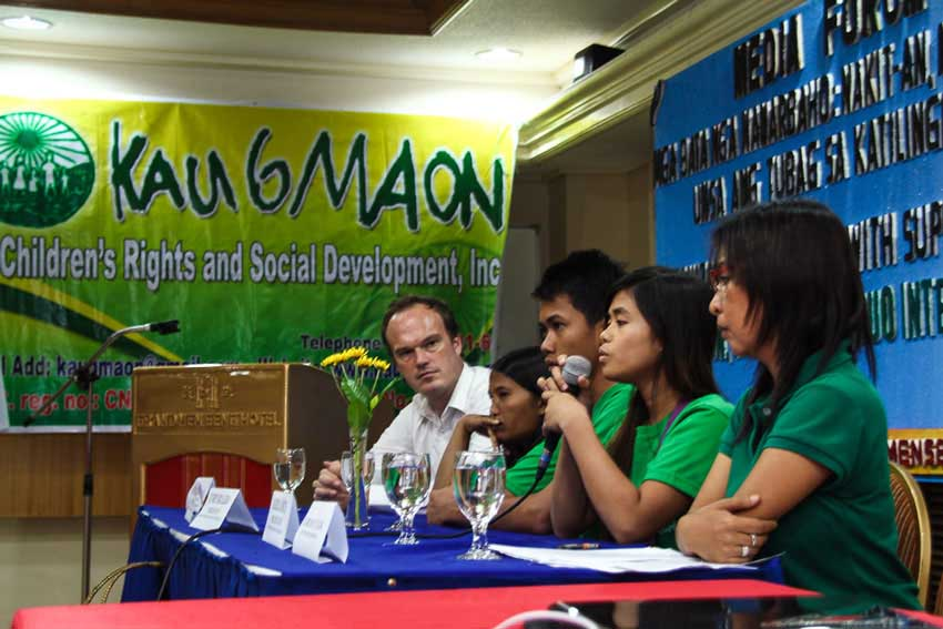 During Kaugmaon Foundation's forum on child labor action Tuesday, child peer counselor Hazel Cañete shares her experience as a fertilizer packer as AWO International Southeast Asian Region Director Martin Liberantz (left) listens.