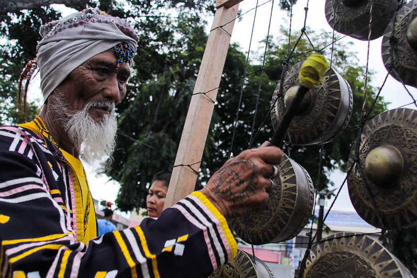 An Uvu-Manobo plays his Kulintang instrument at the Rizal Park during the  opening of the 29th Kadayawan Festival.