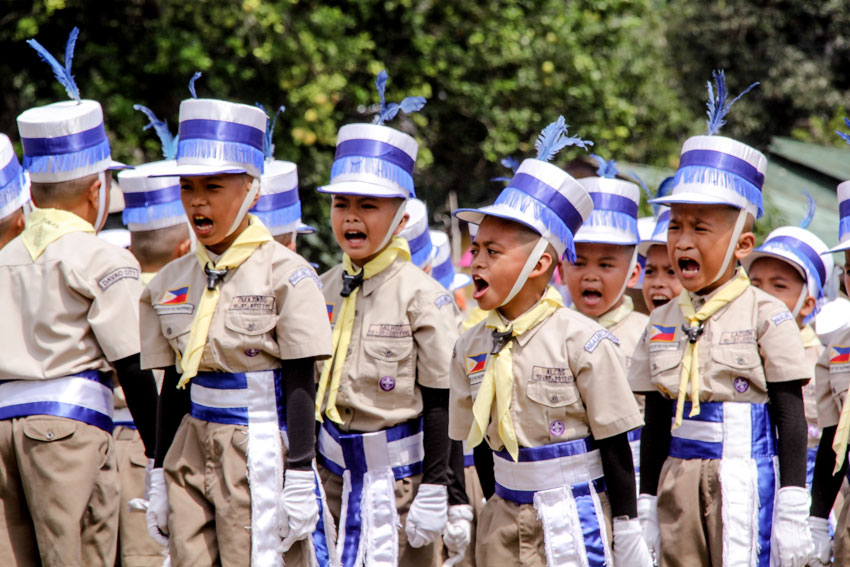 Magallanes Elementary School Boy Scouts shout out their cheering for their delegation during the fancy drill performance at the Camp Malagos, Calinan where the BSP Council Palaro 2014 was held.