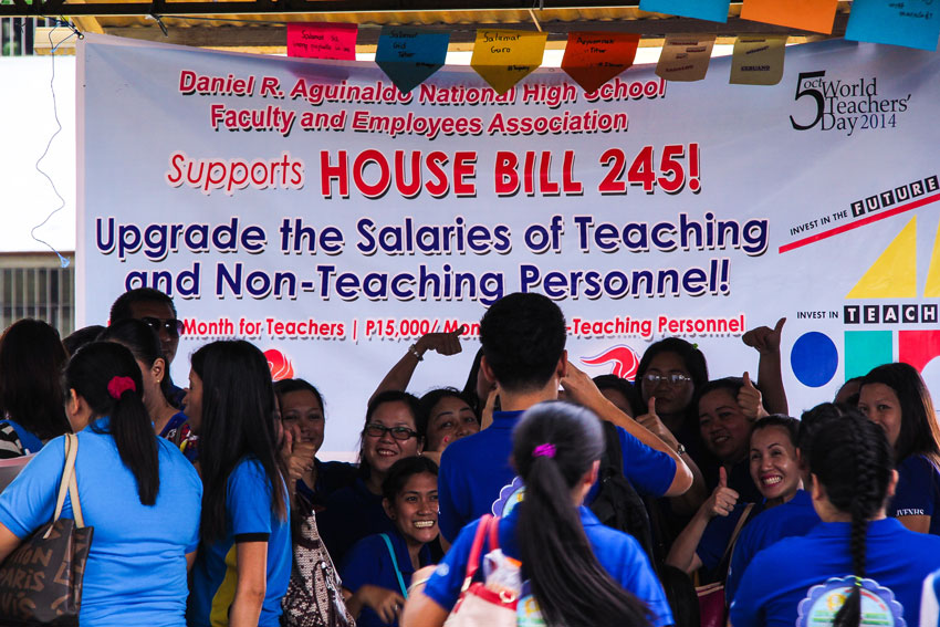 THUMBS UP. Teachers pose behind the banner calling for salary increase. House Bill 245 which was filed by ACT Teachers Partylist seeks to increase the minimum salaries of teaching and non-teaching personnel in public elementary and secondary schools. (Ace R. Morandante/davaotoday.com)