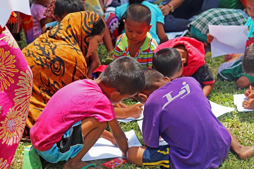 Children from Barangay Madia, Datu Saudi-Ampatuan, Maguindanao province, go on with their daily lives as the AFP's all out offensive rages on against the Bangsamoro Islamic Freedom Fighters. A Peace and Humanitarian Mission conducted in the area by the People's Council for National Unity, Reform and Peace includes a psychological intervention for children. (contributed by Jaazaniah Necosia/ RCPA Productions)