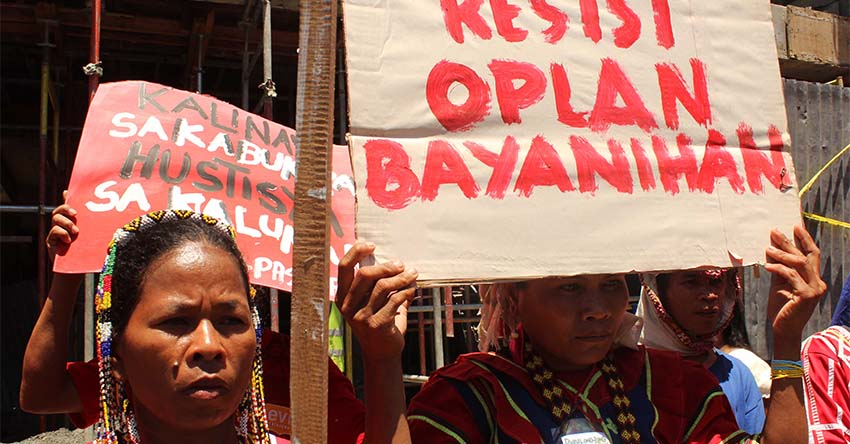 Lumads form human chain outside AFP camp to protest abuses