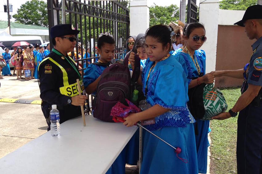 Even performers for the opening ceremony of the 2015 Palarong Pambansa submit themselves for inspections by security personnel guarding both the entrance and exit gates at the Davao del Norte Sports and Tourism Complex in Tagum City today. (Mart D. Sambalud/davaotoday.com)