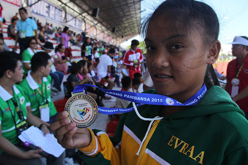 Rose Marie Olovida from Eastern Visayas gets a gold medal on the long jump secondary girls event during the 2015 Palarong Pambansa in Tagum City, Davao del Norte. (Ace R. Morandante/davaotoday.com)