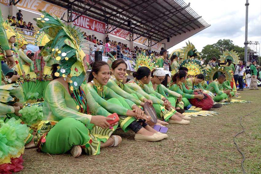 Performers from Department of Education Davao del Norte wait for their turn as the parade of athletes, coaches and guests are ongoing during the 2015 Palarong Pambansa opening ceremony. (Mart D. Sambalud/davaotoday.com)