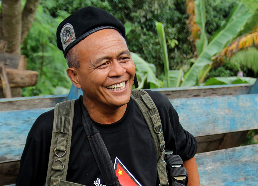 Leoncio Pitao alias Ka Parago flashes a smile to the members of the press during the release of five prisoners-of-war on July 31, 2013 in Paquibato District, Davao City. The five POWs belonged to the 60th Infantry Battalion of the Army and were held captive by the New People's Army for 44 days. (Ace R. Morandante/davaotoday.com)