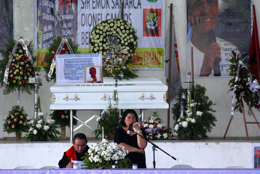 "Yosie Samarca, wife of the slain Executive Director of Alcadev Emerito ""Emok"" Samarca, is overwhelmed by the crowd who attended the mass at the capitol gym of Butuan  City."