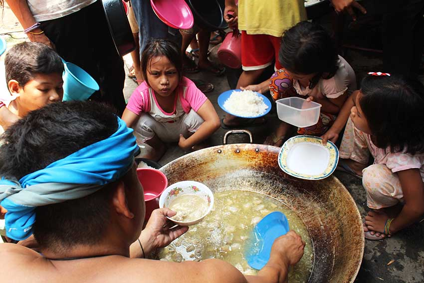 At 11:30 am, Lumad children get their share of food at the kitchen inside the evacuation camp in the United Church of Christ in the Philippines Haran compund.(Medel V. Hernani/davaotoday.com)
