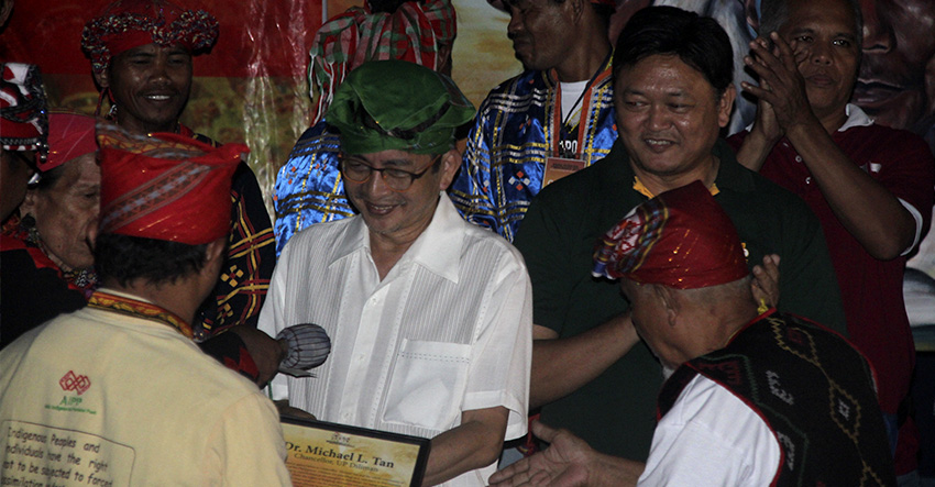 TUBAW. University of the Philippines Diliman Chancellor Michael Tan (in green tubaw) accepts the tokens of appreciation from the lumads of Manilakabayan 2015 during the 'Gabi ng Pasasalamat' prepared by the lumads at the College of Human Kinetics on Friday evening. (Earl O. Condeza/davaotoday.com)