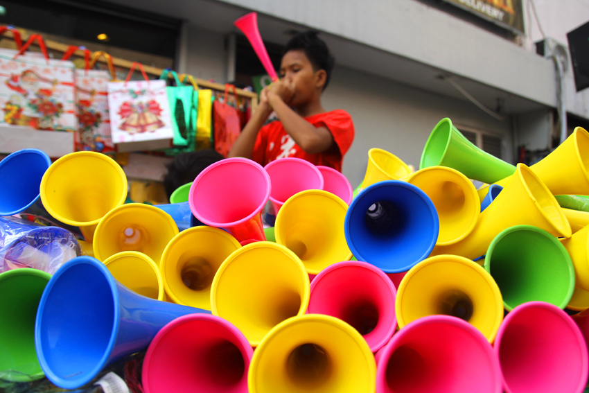 "Instead of using firecrackers, homemade horns called ""torotot"" is a fast-selling product during Christmas and New Year season in Davao City. The city has Ordinance No. 060-02 which prohibits the manufacture, sale, distribution, possession or use of firecrackers or pyrotechnic devices and similar explosives. The ordinance was signed in 2002. (Ace R. Morandante/davaotoday.com)"