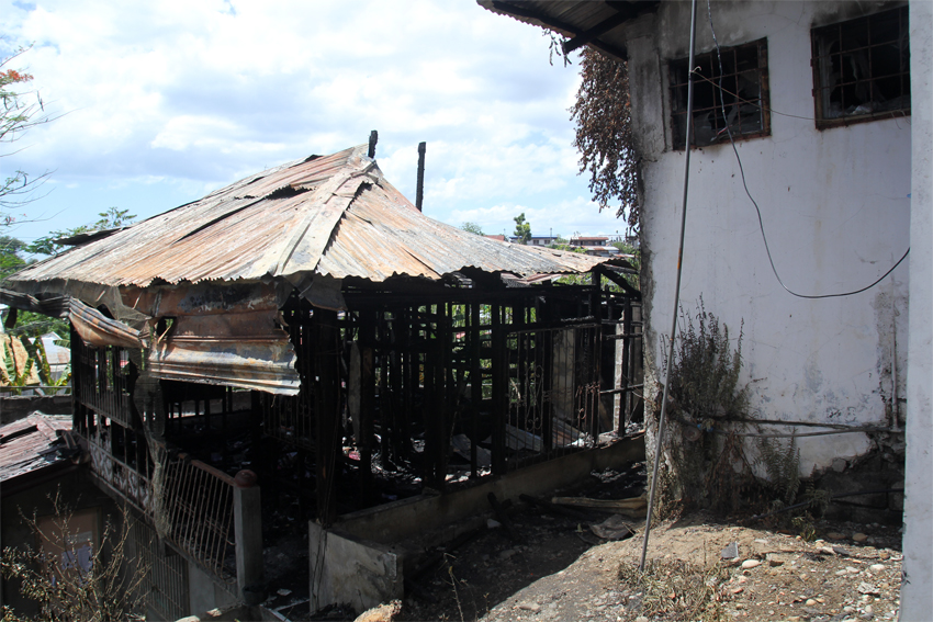 FO1 Rogel Jan Alucilja, investigator at the Bureau of Fire Protection says their initial investigation shows that the fire inside the UCCP compound was deliberately instigated. (Photo by Ace Morandante/davaotoday.com)