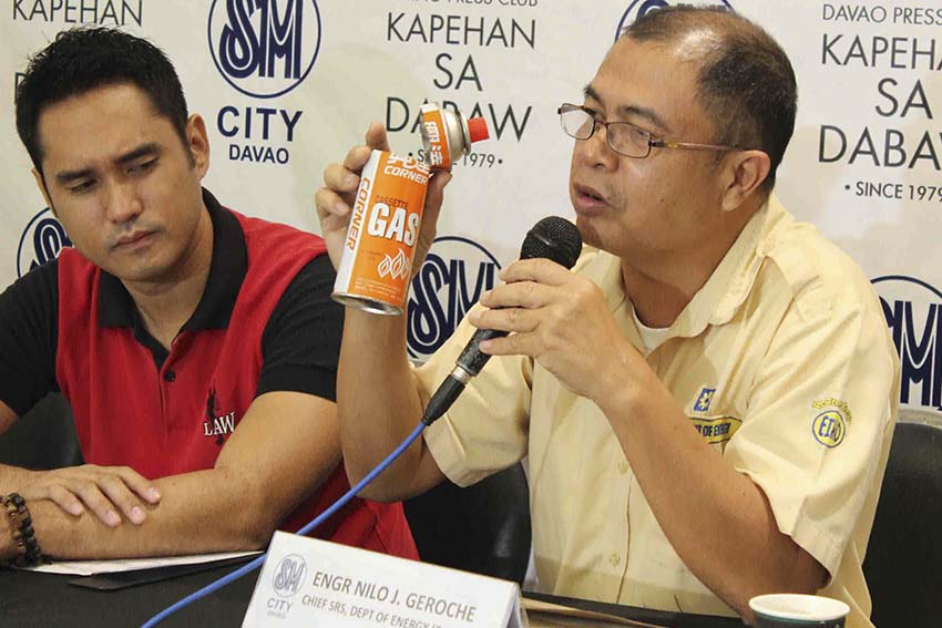 Department of Energy Chief, Engr. Nelo J. Geroche urges the media to help disseminate information regarding the danger of using butane when cooking inside the house. Geroche shows a butane canister which he said is designed only for outdoor use. (Medel V. Hernani/davaotoday.com)