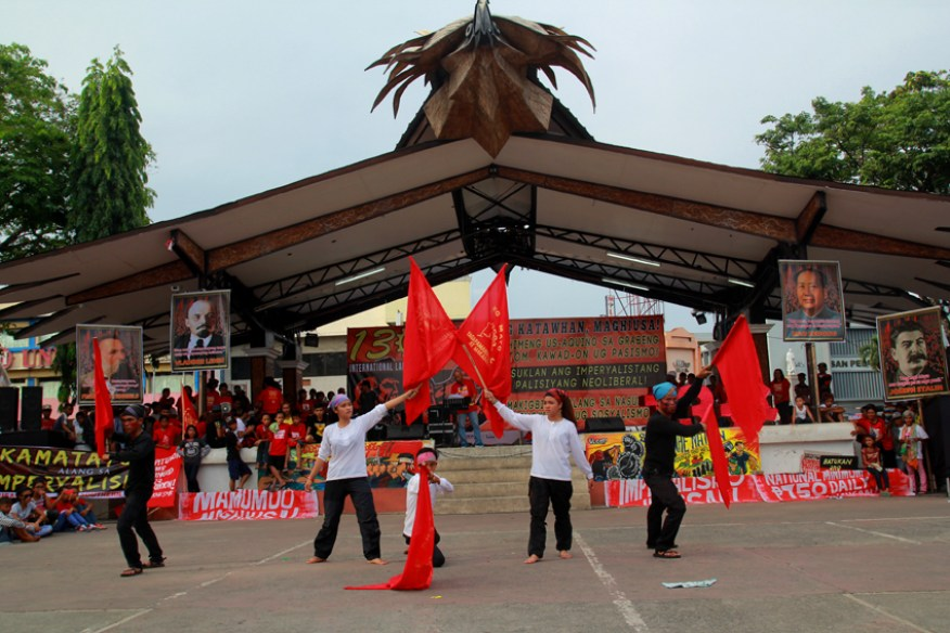 A cultural group performs a dance depicting the situation of workers in the Philippines.