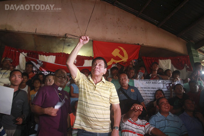 PDP-Laban standard bearer Rodrigo Duterte clenches his fist as he greets the crowd during the release of the New People's Army prisoners in San Luis, Agusan del Sur on Tuesday, May 3. Duterte also received six prisoners of war released by the NPAs last week. (Ace R. Morandante/davaotoday.com)