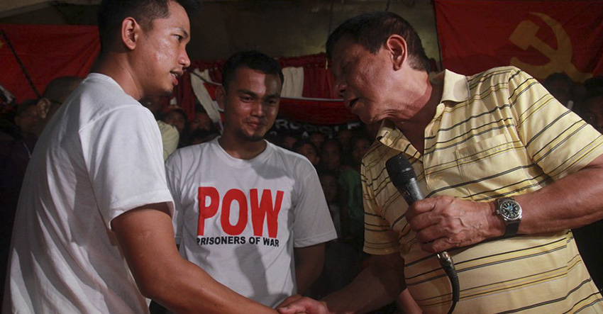 Photo caption: Presidential aspirant Rodrigo Duterte shakes hand with Private First Class Glen Austria and Pfc Diven Tawide who were released by the New People's Army on Tuesday in Agusan del Sur. (Ace R. Morandante/davaotoday.com)