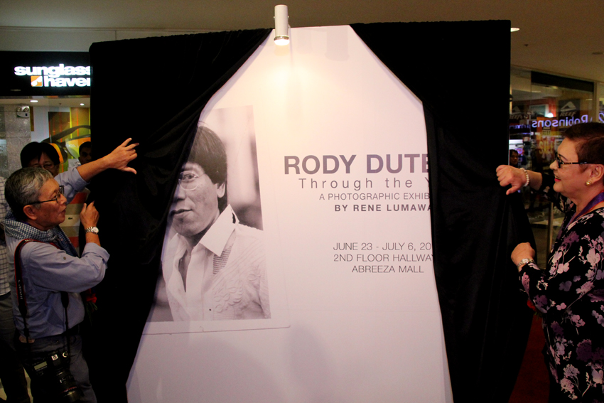 Veteran photojournalist Rene Lumawag and Elizabeth Zimmerman, the first wife of President-elect Rodrigo Duterte unveil the photo exhibit Rody Duterte: Through the years on Thursday afternoon, June 23 at the 2nd floor of the Abreeza Mall in Davao City.