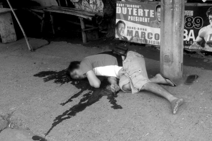 Nestor Siazon, 30, sprawls bloodied in the pavement beside his mini shop at the corner of Damosa, Lanang, Davao City. Witnesses tell police probers he was killed by two men in motorcycle at around 10:00 am on Friday. (Photo by MPG-DCPO)