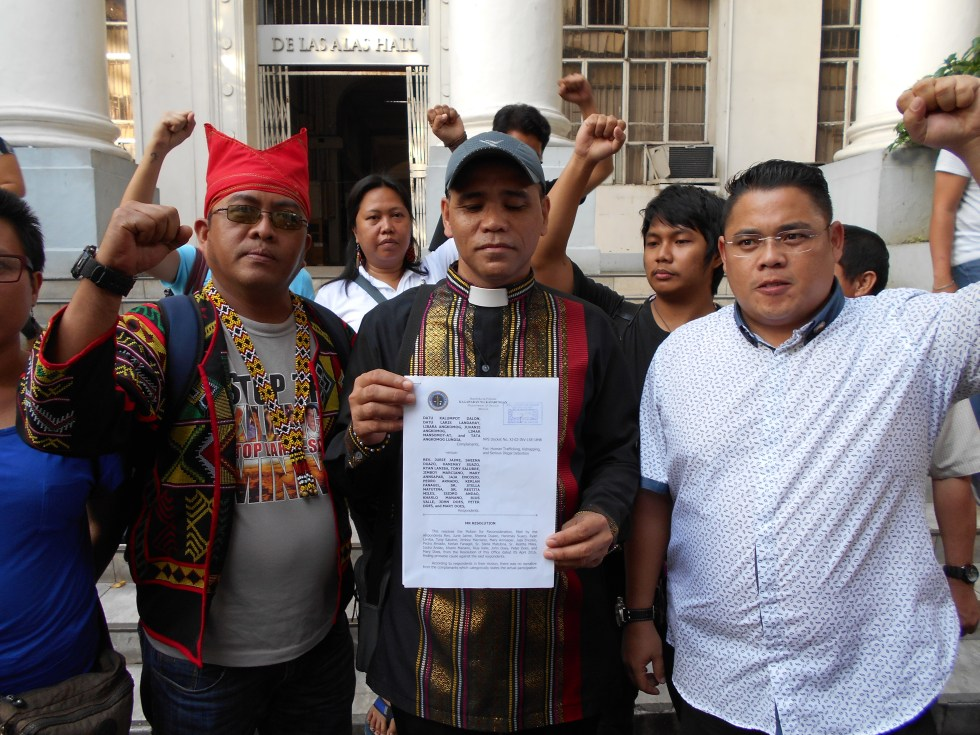 CASE DISMISSED. Activists who were accused of kidnapping indigenous people evacuees in Davao City are elated with the decision of the Department of Justice to dismiss their case on Monday afternoon at the DOJ office in Manila. Reverend Jurie Jaime, convenor of the Exodus for Justice and Peace, holds the copy of the DOJ resolution. He is flanked by Kerlan Fanagel, chairperson of the Pasaka Confederation of Lumad Organizations in Southern Mindanao (on the left) and Anakpawis Partylist Rep. Ariel Casilao. Mary Ann Sapar of Gabriela and Rius Valle of Children's Rehabilitation Center are at the back. (Contributed photo)