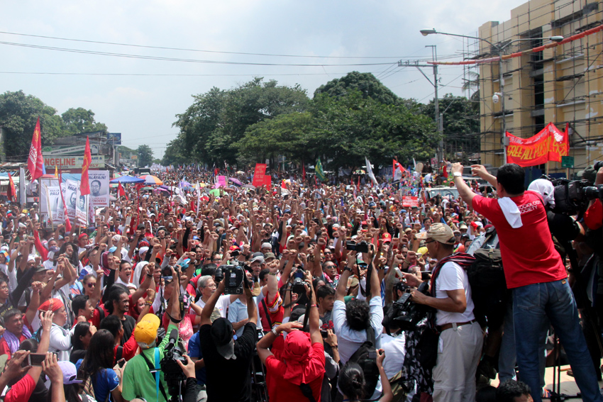 "Upon reaching the venue of their People's SONA, marchers raised their fists to celebrate the ""historic"" occasion of holding the program only a few hundred meters away from Batasan Complex."