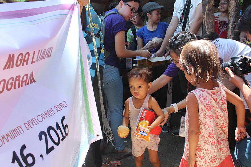 Students of the University of the Immaculate Conception (UIC), Davao City interacts with the Lumad students of the MISFI Academy students as they distribute school supplies at the United Church of Christ in the Philippines Haran compound in Father Selga Street on Saturday afternoon, July 16. (Medel V. Hernani/davaotoday.com)