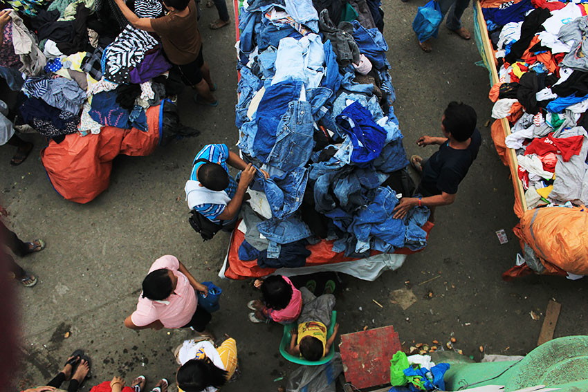 "UKAY-UKAY. Apart from being the biggest source of fresh goods in Davao City, Bangkerohan Public Market is also home to one of the biggest convergence of stalls that sell second hand clothing. These stalls are locally called ""ukay-ukay"" because of the act of rummaging through heaps of clothes in order to get the preferred item. Prices here can go as low as P15 per item or lower if the buyer is good in haggling. (Paulo C. Rizal/davaotoday.com)"