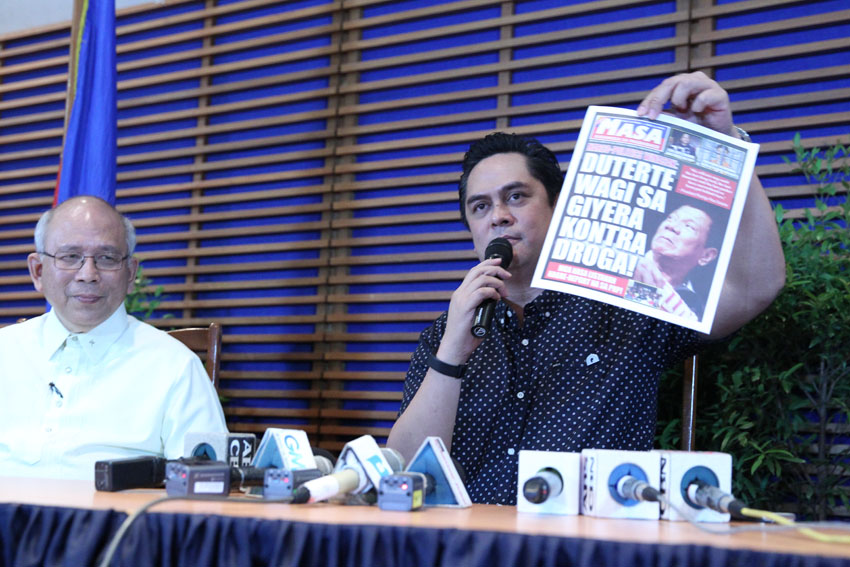 "Communications Secretary Martin Andanar shows a copy of the first issue of the bi-monthly ""Mula sa Masa, Para sa Masa"" publication of the Presidential Communications Office. He said the publication will be distributed for free to give updates on the programs of the Duterte administration. (Medel V. Hernani/davaotoday.com)"