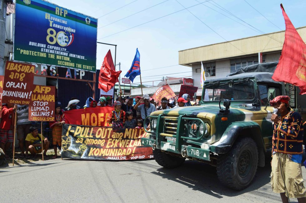 A military truck pass by the rally outside the headquarters of the Eastern Mindanao Command.