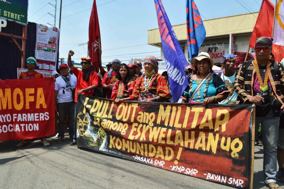 Protesters called for the pullout of military troops in communities during a rally held outside the headquarters of the Eastern Mindanao Command.