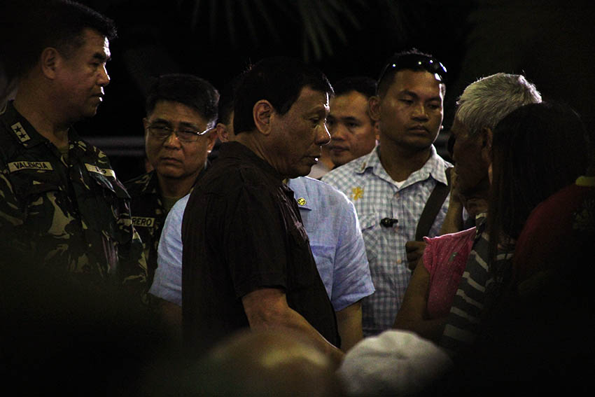 IN CONSOLATION. President Rodrigo Duterte consoles the family members of the four soldiers who were ambushed by the 8th Pulang Bagani Company of the New People's Army in Monkayo Town, Compostela Valley, Friday morning, August 5. Duterte attended the soldiers' wake at the Naval Station Felix Apolinario in Panacan, Davao City around 1:00 am on Sunday, August 7, 2016. (Paulo C. Rizal/davaotoday.com)