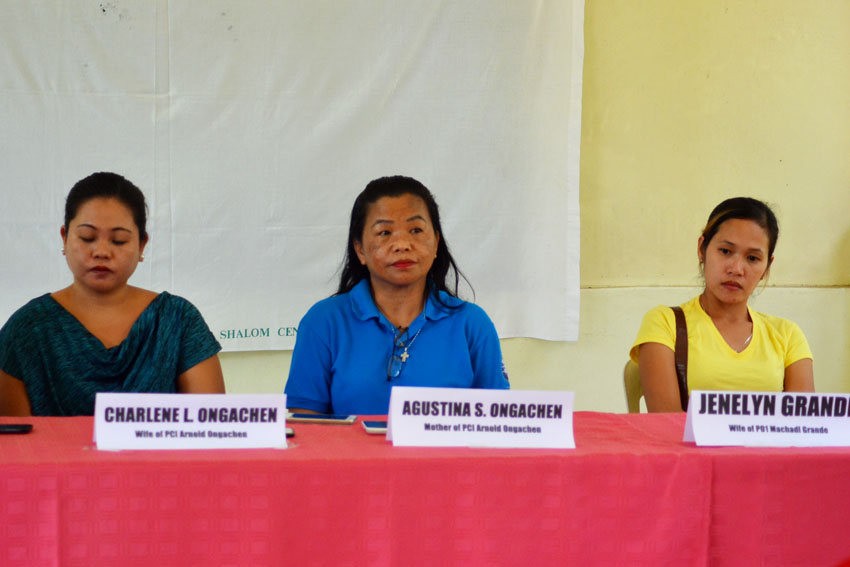 Relatives of the police officials who were captured by the New People's Army as its prisoners-of-war appealed for their immediate release in a press conference on Thursday, August 18 at the United Church of Christ in the Philippines Haran compound. From left: Charlene Ongachen, wife of Governor Generoso Municipal Police  Station Police Chief Inspector Arnold Ongachen; Agustina Ongachen, mother of the police officer; and Jenelyn Grande, wife of Police Officer 1 Michael Grande. (Zea Io Ming C. Capistrano/davaotoday.com)