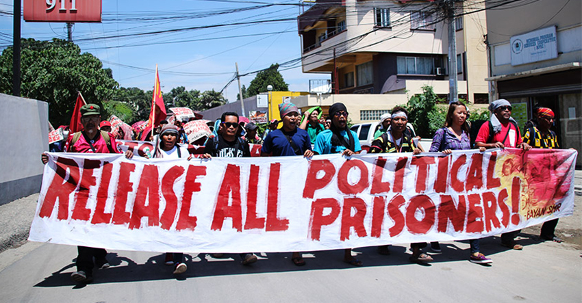 "Farmers and Lumad march from the  the National Commission for Indigenous Peoples Region XI office to the Benigno S. Aquino Hall of Justice in Ecoland, here to call for the release of political prisoners and the dismissal of ""trumped up"" charges against them on Wednesday morning, August 24. (Paulo C. Rizal/davaotoday.com)"
