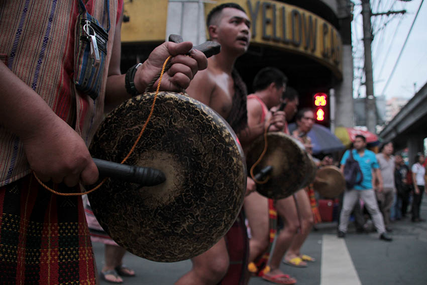 GONG PLAYERS. Tribal men of Cordillera People's Alliance wear traditional vestments as they play the traditional instrument, gong, during the protest march.