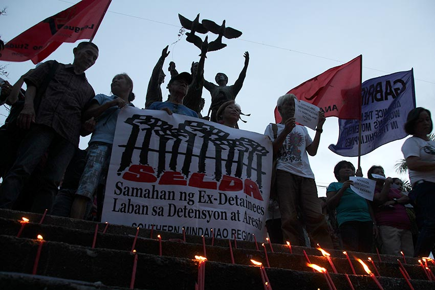 Martial law victims who are members of the Samahan ng mga Ex-Detainees Laban sa Detensyon at Aresto staged a rally condemning the decision of the Supreme Court to allow the hero's burial for former president Ferdinand Marcos in San Pedro Street, Davao City on Wednesday, Nov. 9. (Paulo C. Rizal/davaotoday.com)