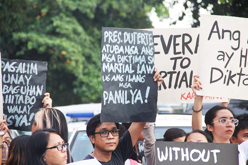 FACE THE NATION. A protester brings a placard telling President Rodrigo Duterte to face to the victims of Martial Law as what he promised during his campaign period before making decision on the Marcos' burial. (Earl O. Condeza/davaotoday.com)