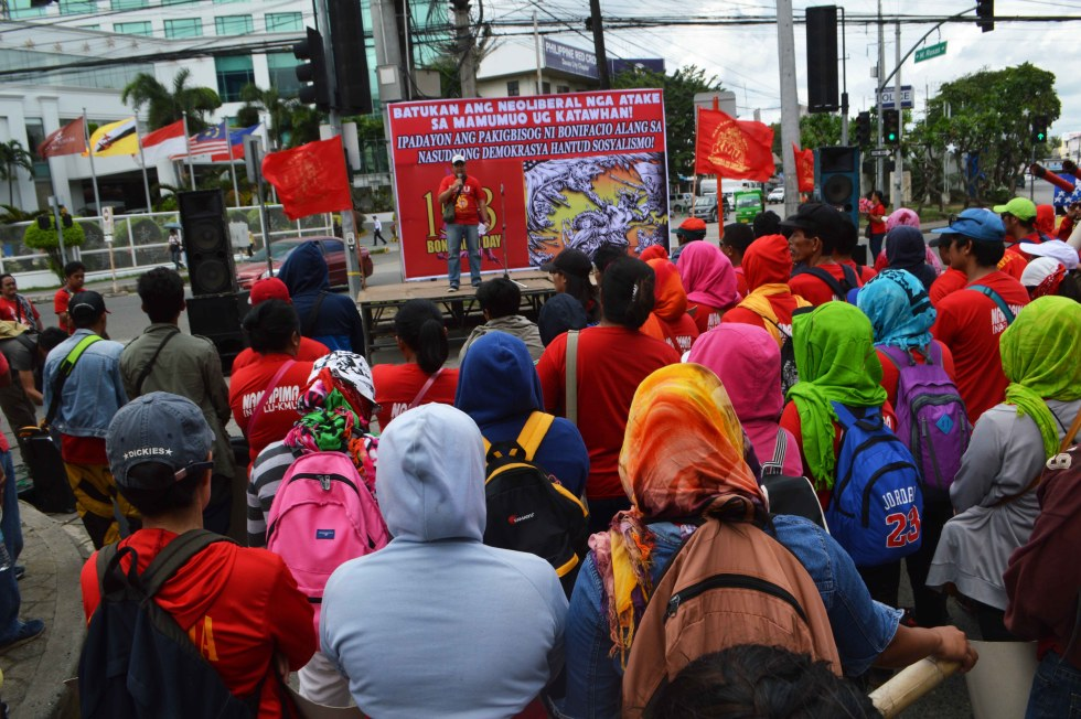 Workers led by the militant Kilusang Mayo Uno gather at the Freedom Park in Davao City to commemorate the 153rd birth anniversary of national hero Andres Bonifacio. The workers criticized US intervention which they said is a way of emulating the patriotic spirit of Bonifacio who fought the Spanish colonizers. (Medel V. Hernani/davaotoday.com)