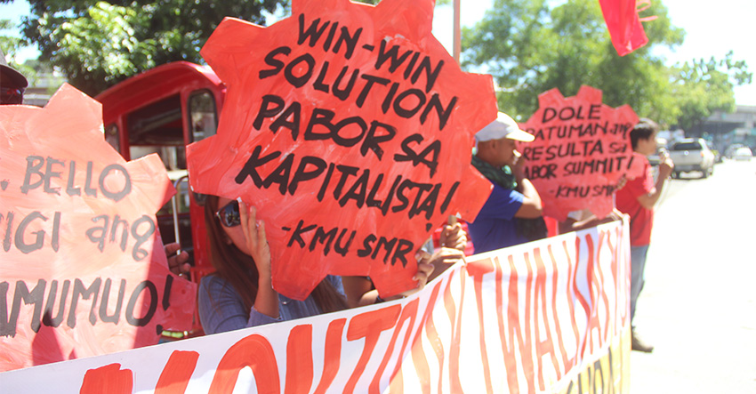 "The progressive labor group Kilusang Mayo Uno in the Davao Region protest last Dec. 8 to Labor Secretary Silvestre Bello III's ""win-win solution"" to end the practice of contractualization across the country. (Earl O. Condeza/davaotoday.com file photo)"