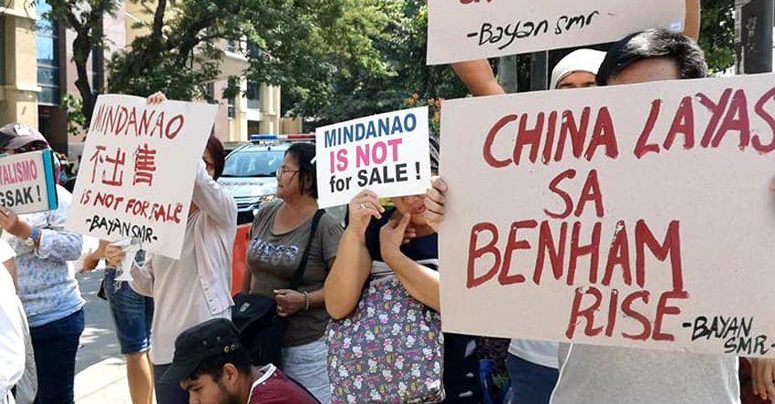 Militants hit Duterte's subservience to China as 29 'lopsided' agreements signed