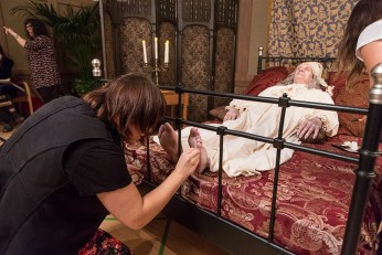 Marisol work attends to the dead man's feet