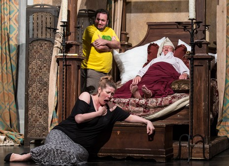 Zita (Alissa Anderson) and Simone (Scott Levin) shed crocodile tears over the corpse of Buoso Donati (Brooks Firestone)