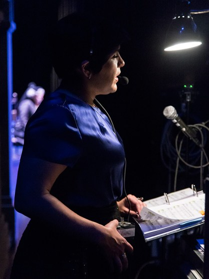 What makes it all run smoothly? Stage Manager Kourtni Knoll calling the show from backstage.