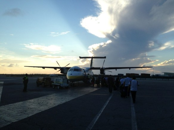 Boarding Bahamasair's turboprop Bombardier Dash 8.